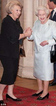 Her Majesty greets the Queen of the Netherlands in the rare meeting of world monarchs.