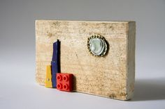 Sustainable artwork primitive wall art from reclaimed wood and found objects [T052]
