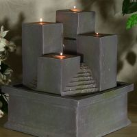 Combining the beauty of fire and water, this indoor tabletop water fountain or outdoor fountain trickles out of the back pillar down the faux stone steps, highlighted by feng shui four pillars with tealight candles. Small Indoor Water Fountains, Indoor Tabletop Fountains, Feng Shui Water Fountain, Bamboo Water Fountain, Tabletop Water Fountain, Indoor Fountain, Fountain Ideas, Diy Tisch, House Plants Decor