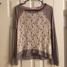 Hi-Lo Lace Sweatshirt Only worn once. Cute see through lace flowers on the front with rhinestones all over. Sorry, I don't trade. Jolt Sweaters Crew & Scoop Necks