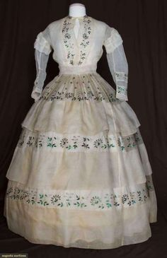 A Civil War era organdy dress with beetle wing embroidery.
