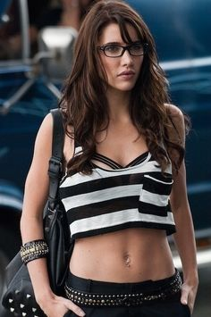 """Hot look.   The loose, long hair, the sort-of """"sexy nerd"""" glasses, and the black and white stripes."""