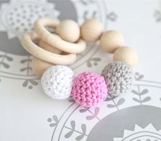 Teething toy with crochet wooden beads and 2 wooden rings. Light grey, pink, white wooden beads rattle.. $17.00, via Etsy.
