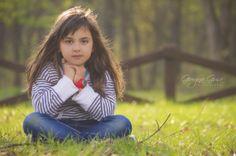 Cute little girl sitting on the grass