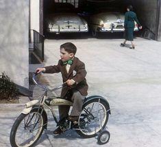 A Schwinn bike and its garage-mates circa 1949, from a set of 35mm Kodachromes.