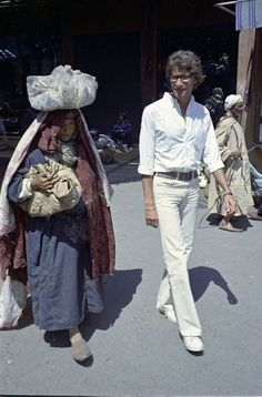 Yves Saint Laurent walking through a marketplace in Marrakech in March 1972.