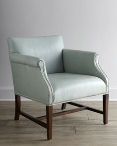 """Cool-ish - BUT - flatten out the arm, only have nailheads along the bottom seam and upholster in a gray mohair, put the wood legs in a weathered black finish - EVEN BETTER -  """"Preston"""" Leather Chair by Martha Stewart at Horchow."""