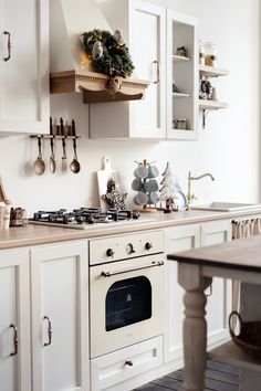 Christmas decorations in a white Scandinavian kitchen