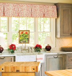 A neat, box-pleat valance frames a bank of windows.