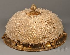 ART DECO BEADED GLASS CEILING LIGHT GLASS AND CAST METAL CIRCULAR BRASS FINISH FIXTURE WITH GLASS BEADS COVERING DOME CENTERED BY A ... - 20TH CENTURY FURNITURE & DECORATIVE ARTS - SALE 2531B - LOT 333 - Skinner Inc