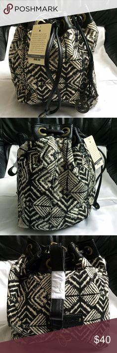"""Lucky Brand Bali Hai Black White Bucket Sling Bag Brand new with tags, never used. Retails for $88! This Lucky Brand Bali Hai Black and White Drawstring Bucket Sling Bag is the perfect size bag! Can be worn as a shoulder bag or as a backpack style (pictures on how to wear the bag is in a 2nd listing). Magnetic closure, adjustable drawstring closure, hanging decorative Lucky Brand charms and adjustable straps. Cotton/linen and faux leather. Measures approximately 12"""" x 8"""". I also have the…"""