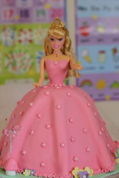 My First Doll Cake - I took the Wilton doll head off and replaced it with Sleeping Beauty. This was my daughters Birthday cake and she was delighted. Barbie Doll Birthday Cake, Barbie Torte, Bolo Barbie, Barbie Cake, 4th Birthday Cakes, Barbie Dress, Sleeping Beauty Cake, Dress Cake, Cake Tutorial
