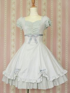 This classy Victorian Maiden dress has several cute details, like the ruffle egded scallops held by bows.
