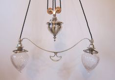 English two arm rise and fall by Osler of Birmingham in the original silver plated finish, complemented by classic Osler feather cut shades. Antique Ceiling Lights, Antique Lighting, Feather Cut, Antique Interior, Exeter, In The Heights, Silver Plate, Plating, Chandelier