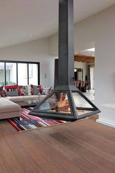 Incredible Contemporary Fireplace Design Ideas - Natural or artificial fireplace models can make both modern and rustic home decorations look highly aesthetic. Artificial fireplace models are general… - Hanging Fireplace, Fireplace Set, Modern Fireplace, Artificial Fireplace, Contemporary Fireplace Designs, Espace Design, Traditional Fireplace, Home Room Design, Interior And Exterior