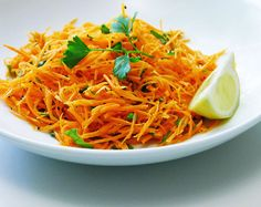 Grated Raw Carrot Salad. Just made this for lunch with a paleo omelette-muffin = yum!