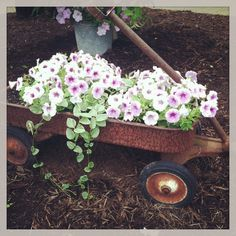 Fill An Old Prim Wagon...with flowers for a primitive garden arrangement.  Picture only for inspiration.