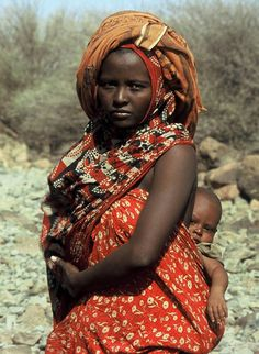 Africa   Portrait of an Afar mother carrying her child, Djibouti, EastEthiopia
