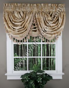 The Reagan waterfall valance is a elegant jacquard fabric in a floral and leaf, accented with a quality bead and rope tassel trim.  #Ascot  #Tassels #Valances