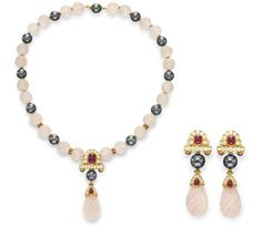 A SET OF ROSE QUARTZ, DIAMOND AND MULTI-GEM JEWELRY, BY BOUCHERON  Comprising a necklace, suspending a sculpted rose quartz pendant from a circular-cut diamond, cabochon ruby and black cultured pearl link, to the neckchain designed as a series of sculpted rose quartz beads, spaced by black cultured pearls and circular-cut ruby rondelles; and a pair of ear pendants en suite, mounted in 18k gold, 1984, 15 ins., with French assay marks and maker's marks Each signed Boucheron, $158,500.00
