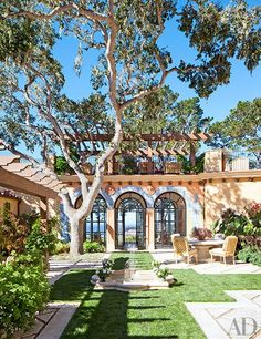 The courtyard is outfitted with hand-painted tilework around the arches | archdigest.com