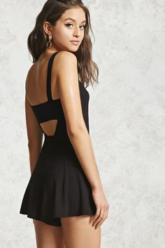 A sleeveless knit romper featuring a back cutout, a slight sweetheart neckline, and a flared silhouette.