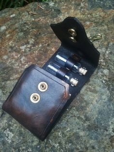 This would be so awesome for essential oils!!! Steampunk apocalyptic Vial Holster Holds up to 5 by SkinzNhydez,
