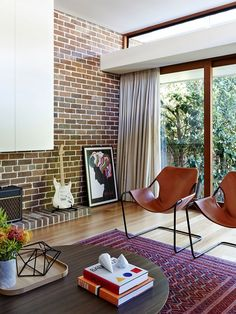 Fabulous use of the twin Paulistano Armchairs in the living room