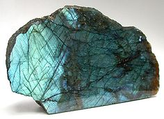 Labradorite is also called Spectrolite referred to a stone of transformation. Said to clear, balance and protect the aura.