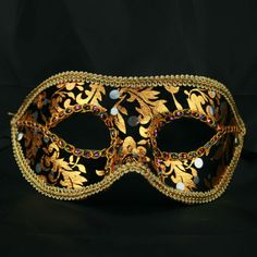 Unisex black and gold brocade mask for a ball