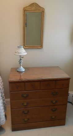 Complete Ethan Allen twin bedroom set w/ matching twin beds, eleven drawer dresser, three drawer chest, vintage wall mirror and vintage glass table lamp.