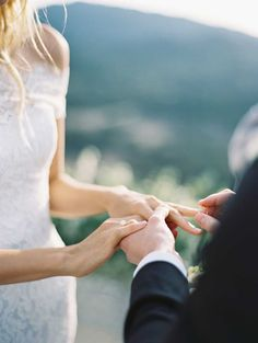 Adorable wedding photograph. Ring exchange. Such a talented photographer. Photograph: Kurt Boomer.
