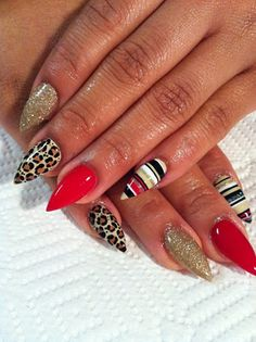 Stiletto Nails... This look kind of scares me a bit but its new trend.