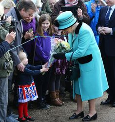 The Queen, who was accompanied by the Duke of Edinburgh, was presented with several bouquets of flowers on Sunday morning including a posy from three-year-old Jessica Atfield