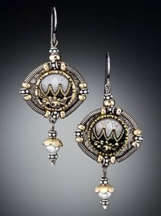 Wendy Witchner - earrings1920 description:  Oxidized and texturized sterling silver metal with hand-coiled sterling silver wire coils, gold filled beads accentuating and framing antique buttons from the 1800's accentuated with dainty gold capped pearl drops.