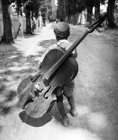 Eva Besnyö. A Gypsy Boy with Cello. Hungary, 1931.
