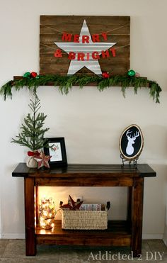 I love this simple entry way decor!  Especially the metal star!