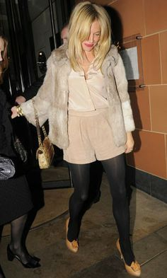 Sienna Miller went for a truly luxe cropped cream fur to finish her nude coloured separates while on a date in London with beau, Jude Law. www.pertlybeast.com