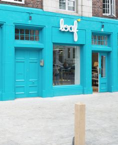 The bright blue frontage with light up logo to Loaf's Notting Hill Shack Retail Interior, Notting Hill, Furniture Showroom, Wonders Of The World, Sink, Bucket, Chairs, Bright, Interiors