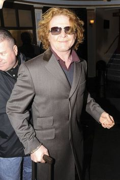 Simply Red singer Mick Hucknall leaving the Ambassador Theatre in London after a Rolling Stones party. 2008