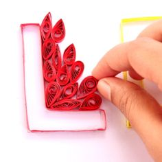 Make letter art out of quilling stripes - Follow @Guidecentral for #crafts and #DIY projects
