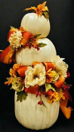 Stacked white pumpkins with soft fall ribbon and floral. Annette at Michaels in Madison, TN.
