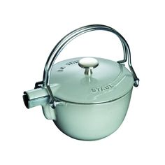 The Staub Round Teapot Kettle in Graphite is a stunning stove to table presentation and keeps your tea/water hot for up to an hour. The included stainless-steel mesh ball lets you brew loose tea without any hassle. Traditional Teapots, Enameled Cast Iron Cookware, Cocinas Kitchen, Cafetiere, Kitchen Gadgets, Kitchenware, Tableware, A Table, Tea Time