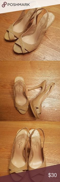 "Jessica Simpson Heels Beautiful Faux Snakeskin Heels. Worn a few times. Signs of wear on bottoms as pictured. Heels tips in nearly perfect condition. Heel measures 4.5"". Pet and smoke free home. I welcome questions and consider reasonable offers. Jessica Simpson Shoes Heels"