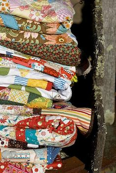 Vintage quilts ~ the second to the bottom looks like one my great aunt made with my great grandmother.