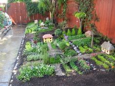 Wee Village. So beautiful. Such a great way to create the walk space needed for weeding and caring.