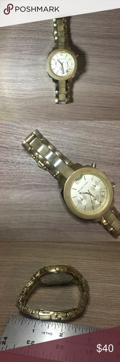 Michael Kors Gold & Horn Watch Beautiful horn detail down the center of the watch & around the face. The face has a chip at the top corner between the 12 & 1, also needs a new battery. Is sized for a smaller wrist. Michael Kors Accessories Watches