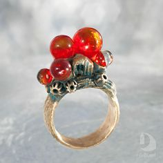 This is cocktail ring with amaranth, red, scarlet, crimson and vivid glass. The ring is very bright. There are the little house in the ring. I think that it can be Mermaids or Sirens ring. It is also jewelry with a botanical and oceanic mood because it contains fragments of natural texture. SIZE by ORDER. Its a unusual beautiful gift for a mom, girlfriend or wife. FREE shipping worldwide  Ring Small house in the rays of sunset The scarlet rays of the setting sun painted the world with a…