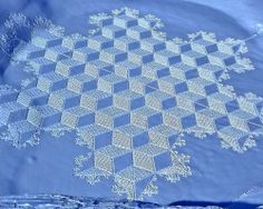 snowflake snow art by Simon Beck