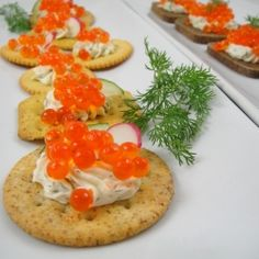 Crackers with Salmon Caviar - Creamy mixture of cream cheese and sour cream, fresh dill- topped with thin slices of radish and caviar give these appetizers a distinct flavor